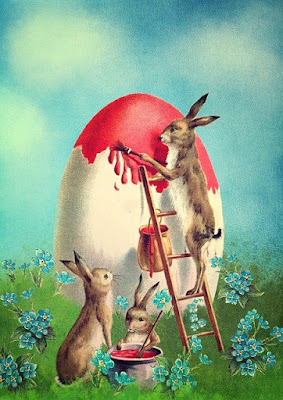 Bunnies painting in red a big egg