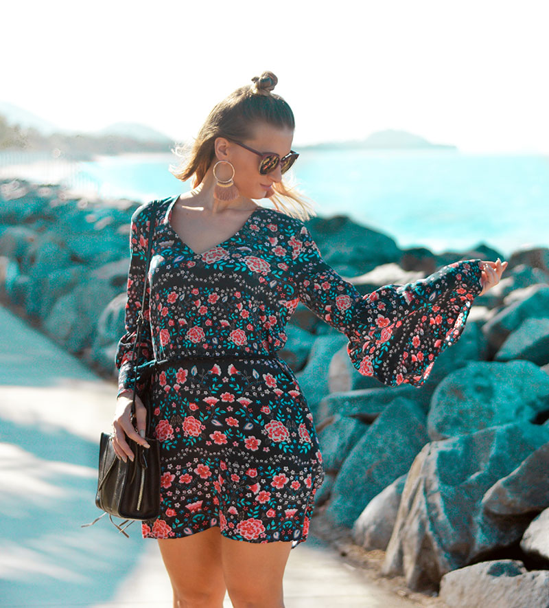 cairns fashion blogger wearing retro floral print dress with flared sleeves and tassel earrings