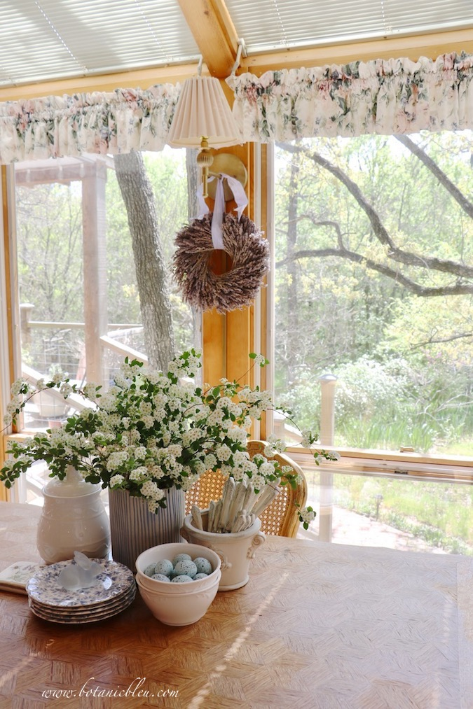 The large white bridal wreath spirea shrub branches made a beautiful flower arrangement on the Easter table