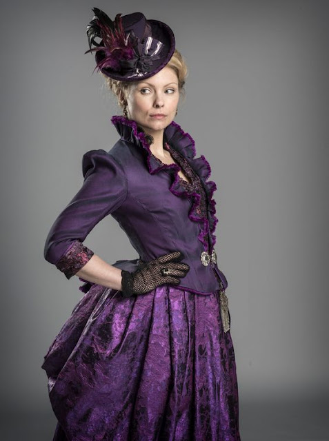 Women's Victorian costume. Purple dress/skirt with fitted jacket, hat, fishnet gloves. Women's Steampunk clothing.