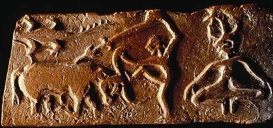 Harappan Molded tablet H95-2486 depicting an individual spearing a buffalo