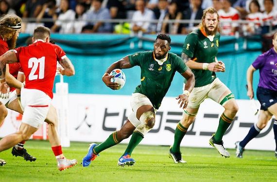 Siya Kolisi runs at Wales' defence at the World Cup with RG Snyman in the background