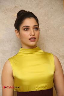 Actress Tamanna Stills in Yellow Dress at Okkadochadu Audio Launch  0002.JPG