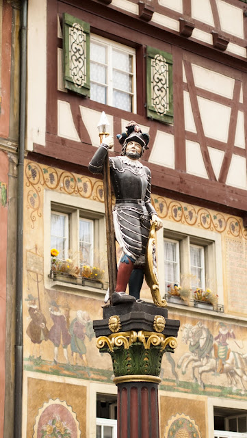 Soldier statue atop a fountain in Stein am Rhein on a day trip from Zurich