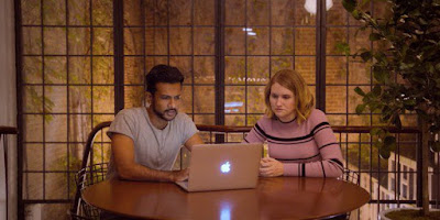 "Jern (Utkarsh Ambudkar) and Brittany (Jillian Bell) make her an online dating profile in Amazon's ""Brittany Runs a Marathon"""