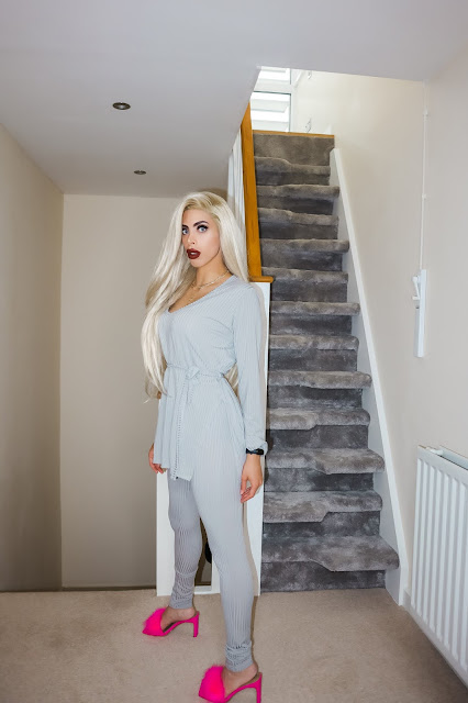 The Femme Luxe Grey Ribbed Belted Loungewear Set in model Asia.