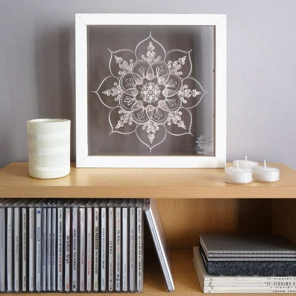 framed lacy quilled mandala on shelf