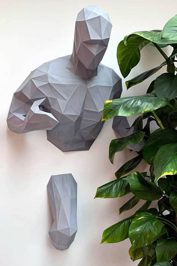3D folded paper running man on wall
