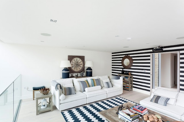 Picture of modern living room with white furniture and blue carpet