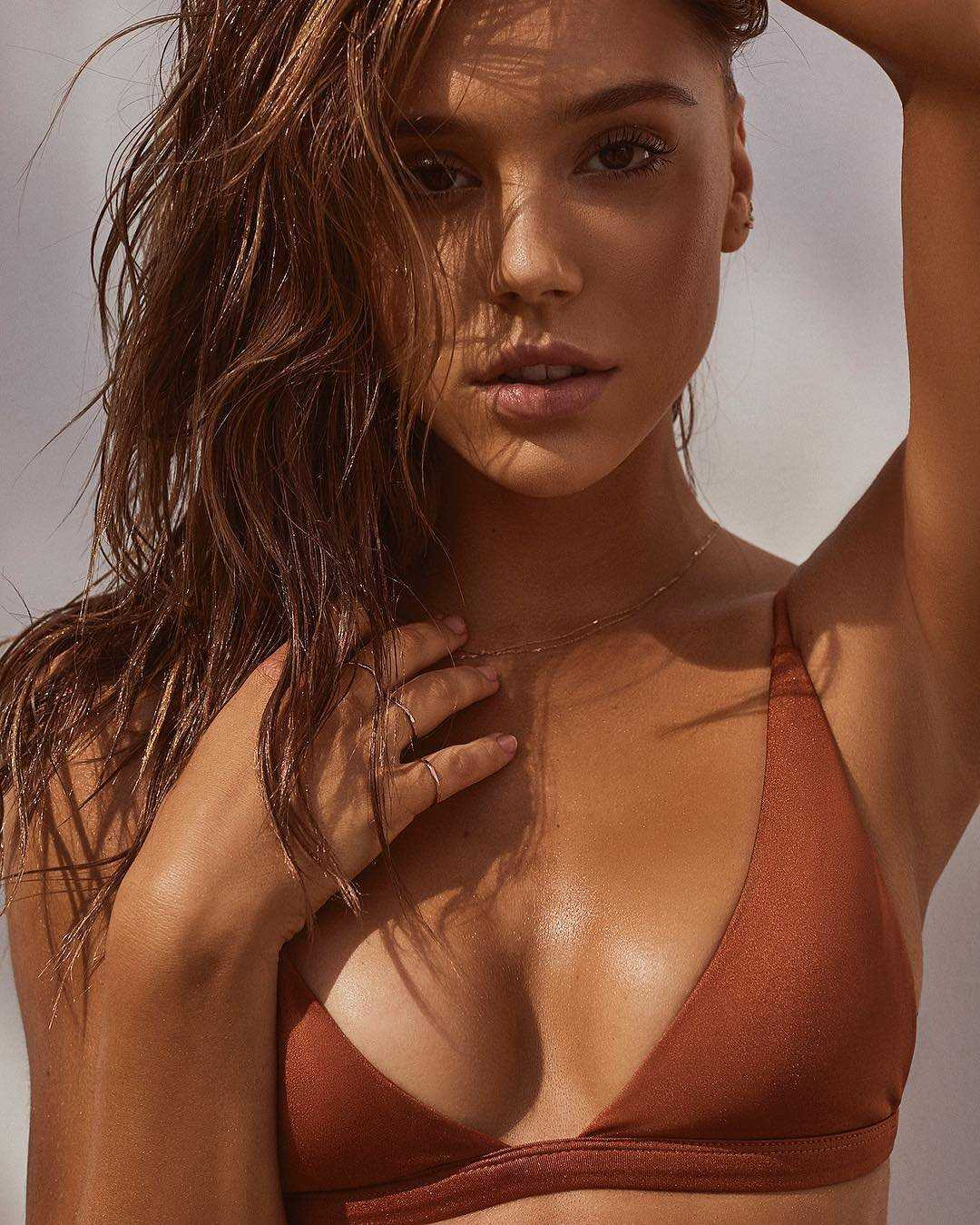 Alexis Ren sizzles as she strips for the Fae Swim Campaign 2016