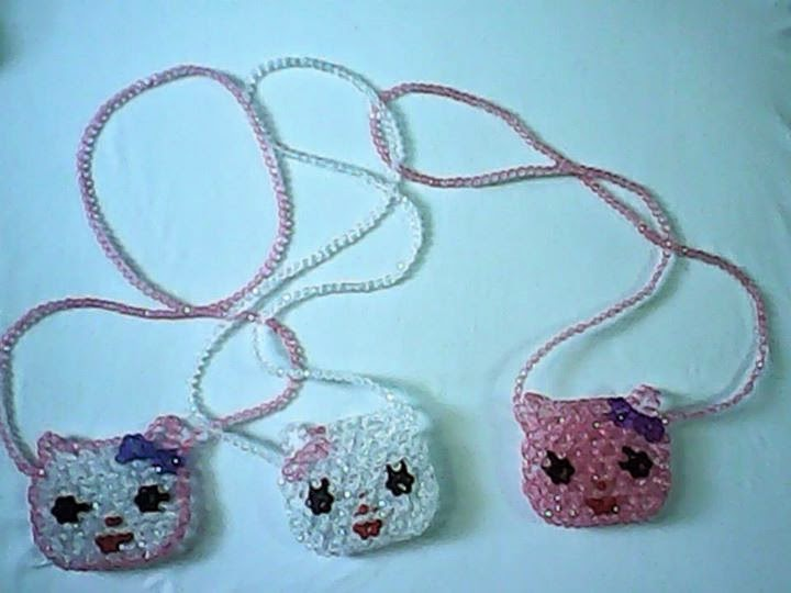 "<img src=""pouches.gif"" alt=""different designs of pouches made of beads "" />"