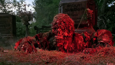 Creepshow 1982 film still showing zombies coming up from the ground bathed in blood