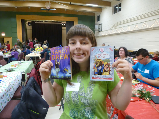Woman proudly showing off the new books she got at the holiday party!
