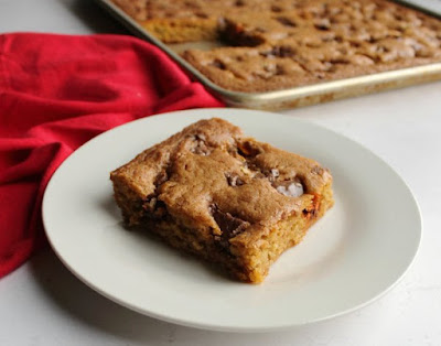 piece of lotsa candy bar blondies on a plate