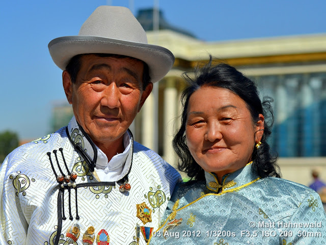 people, portrait, street portrait, double portrait, Mongolia, Ulaanbaatar, Chinggis Khaan Square, Mongolian couple, traditional Mongolian costume, deel