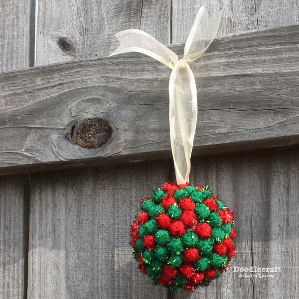 Pom pom ornament with a secret compartment inside! Perfect for Christmas gifts or commitments