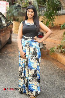 Actress Model Poorni Stills in Floral Long Dress at Silk India Expo Launch  0028.JPG