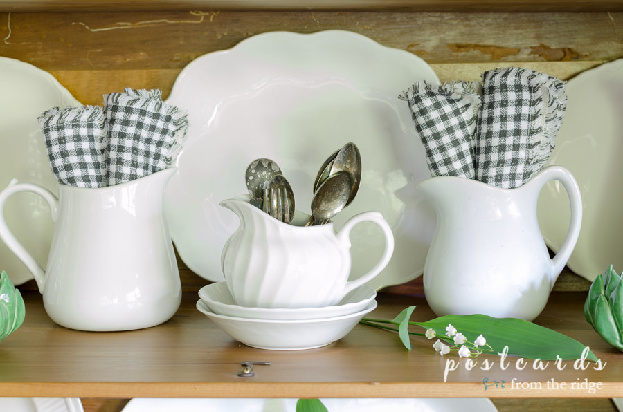 little white ironstone pitchers with black and white napkins