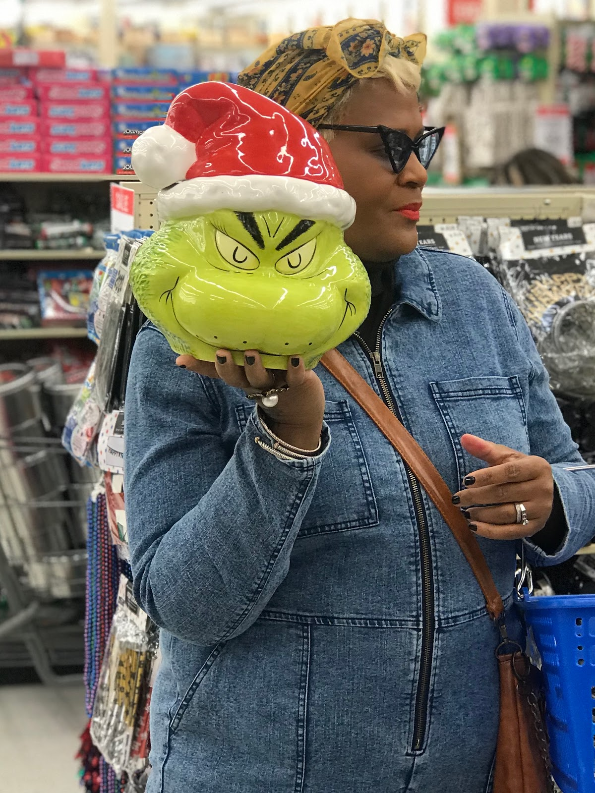 Buying a Christmas Grinch cookie jar from the decor section at Hobby Lobby Craft Store
