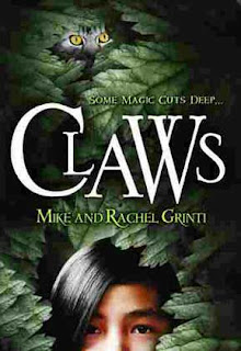 Cover, 'Claws' by Mike and Rachel Grinti. Image depicts tree foliage through which peers a girl with straight black hair, brown eyes, and beige to brown skin, in the bottom of the image frame. Near the top of the frame, peer the gold eyes and partial face of a cat with black-on-gray tabby markings.