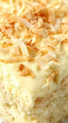 Coconut Pineapple Cake Recipe - sweet and delicious coconut cake with light and fluffy whipped pineapple frosting! Perfect Summer dessert! The coconut cake has a tender crumb and melts in your mouth, all thanks to buttermilk which I my favorite to use in cakes.