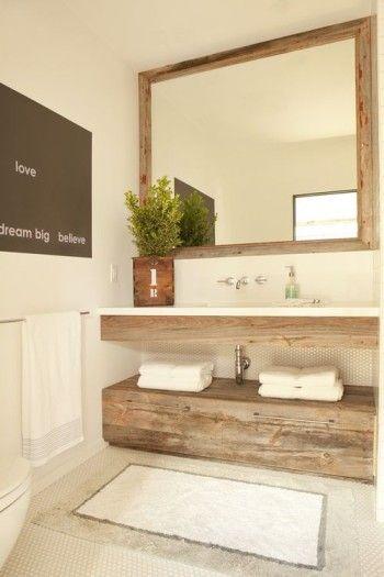 Consigue un baño elegante gracias a pequeños elementos decorativos
