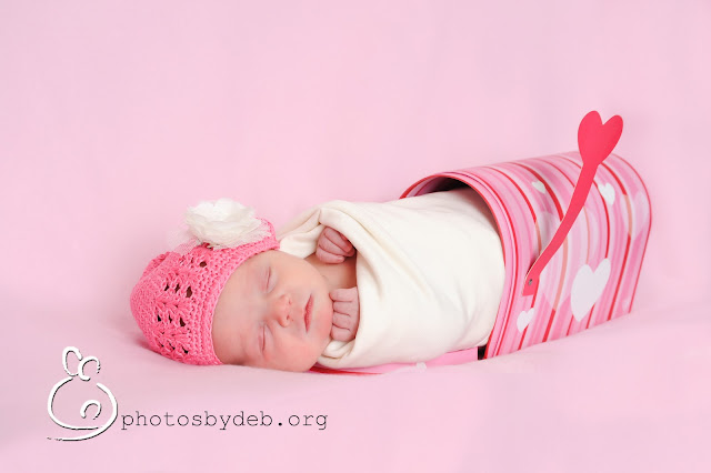 baby in a pink mailbox wrapped up