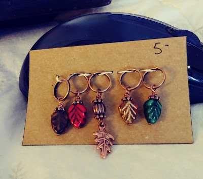 Fall leaf stitch markers from The Wren's Daughter purchased at Gloucester knitting retreat.