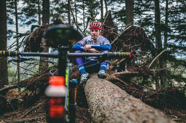Ben Thomas triple national champion cross country mountain bike marathon racer training in the forest.
