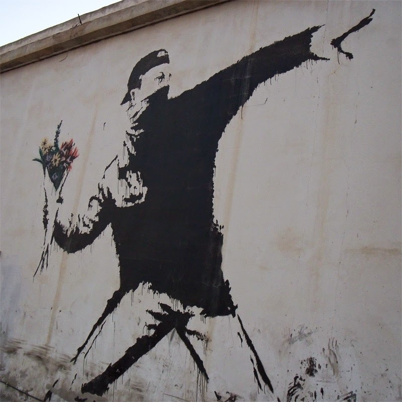 15 Of Banksy's Most Iconic Street Artworks - The Flower Thrower, 2003