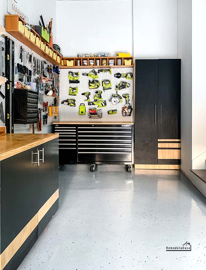 garage with pegboard full of tools - Husky workbench