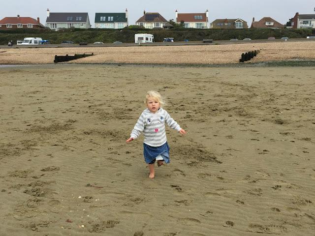 Tin Box Tot running on the sand