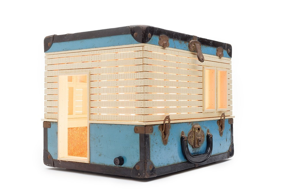 10-Migration-Ted-Lott-Architecture-in-Upcycled-Furniture-and-Suitcase-Sculptures-www-designstack-co