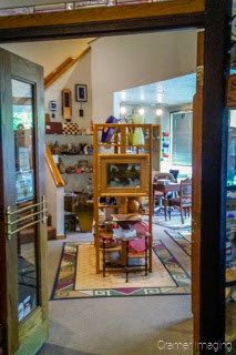Cramer Imaging's photograph of an art gallery with lots of kinds of art for sale