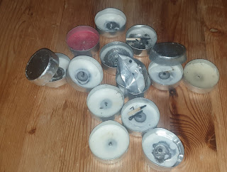 A scattered arrangement of burnt-down and crushed tea lights