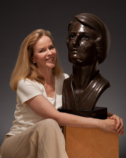 Sandra Shaw and her portrait bust of Ayn Rand
