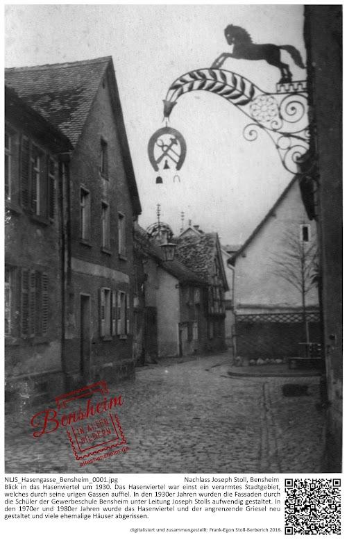 NLJS_Hasengasse_Bensheim_0001.jpg; Nachlass Joseph Stoll, Bensheim; Blick in das Hasenviertel um 1930. Das Hasenviertel war einst ein verarmtes Stadtgebiet, welches durch seine urigen Gassen auffiel. In den 1930er Jahren wurden die Fassaden durch die Schüler der Gewerbeschule Bensheim unter Leitung Joseph Stolls aufwendig gestaltet. In den 1970er und 1980er Jahren wurde das Hasenviertel und der angrenzende Griesel neu gestaltet und viele ehemalige Häuser abgerissen.