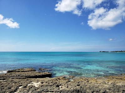 Calm sea with rocky shoreline