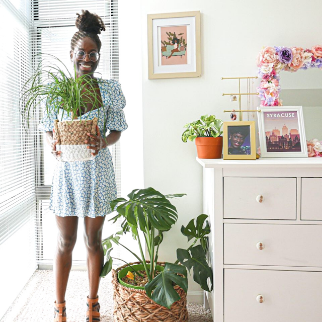 Image of woman holding plant