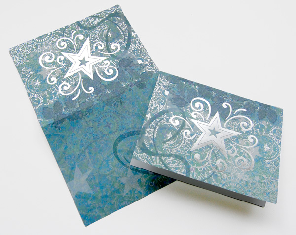 Silver Star ornament with blue swirls note card over head shot.