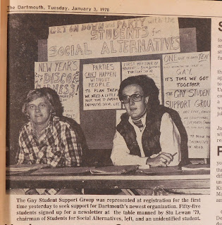 Newspaper photo of table at registration
