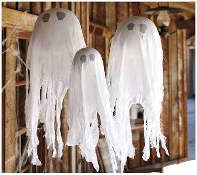 Want to know how to make hanging ghosts from Pottery Barn for a lot less than you can buy them for? Here's a Pottery Barn knock-off that makes the perfect not-so-spooky Halloween decor for your front porch!