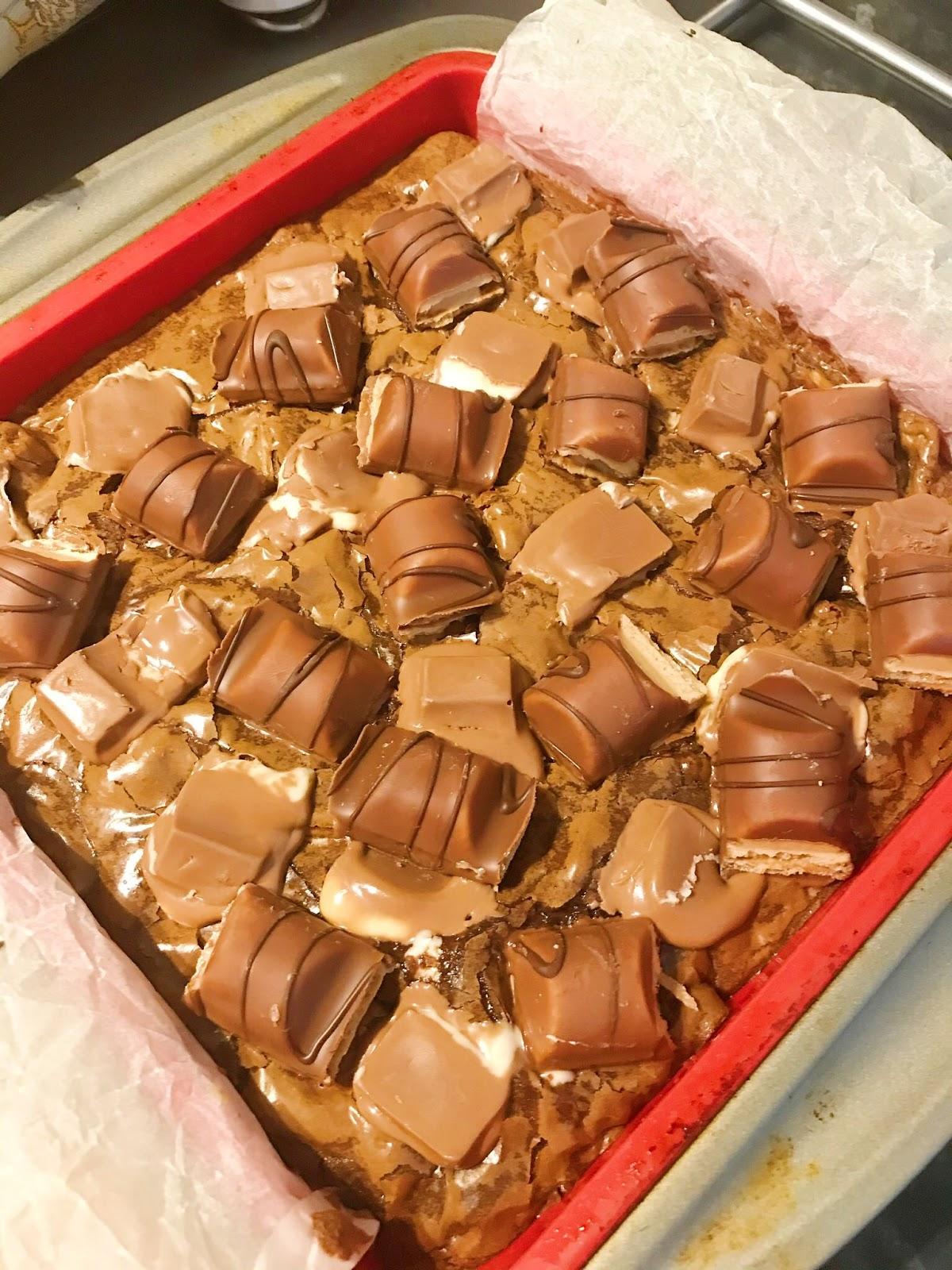 Kinder Bueno brownies in tin halfway through cooking