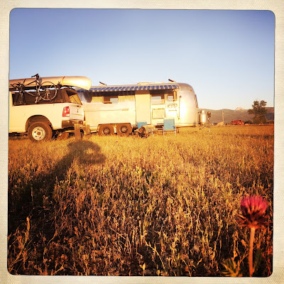 Airstream and truck in field