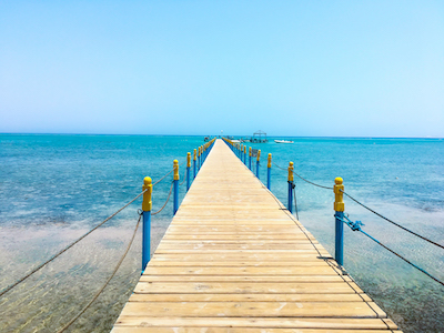 Wooden bridge above the sea stock image
