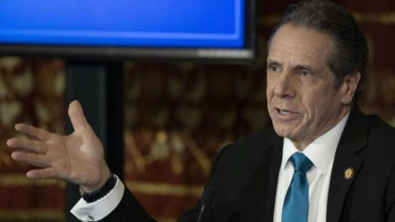 Pressure on New York governor to resign, third woman charged