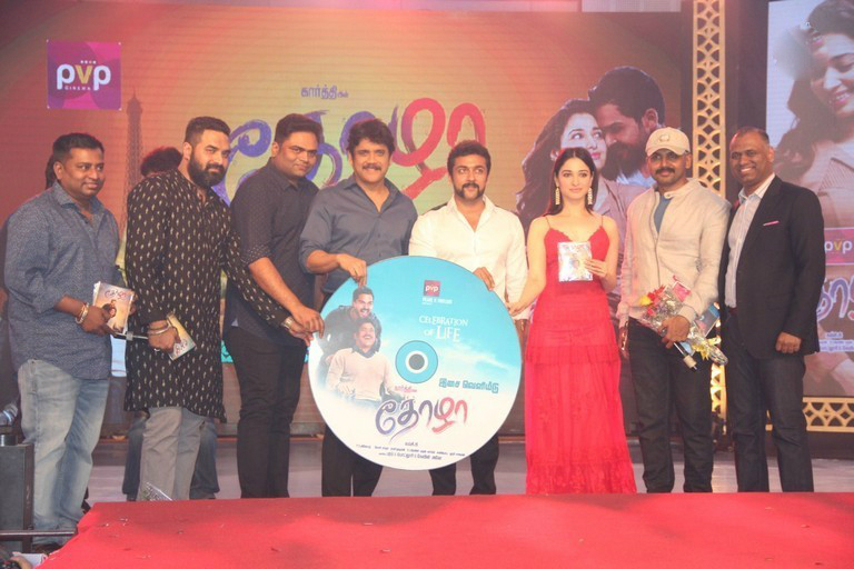 Suriya launches Thozha audio. Nagarjuna, Vamsi paidipally, Tamanna, Karthi, PVp are seen in this picture. Tamanna hot and beautiful, Hot and sensual Tamanna, Hot Tamanna in Thozha-Oopiri audio Launch. hot and sensual Tamanna in Thozha, hot and Sensual tamanna in OOpiri