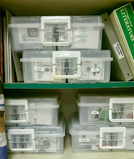 Plastic containers on shelves