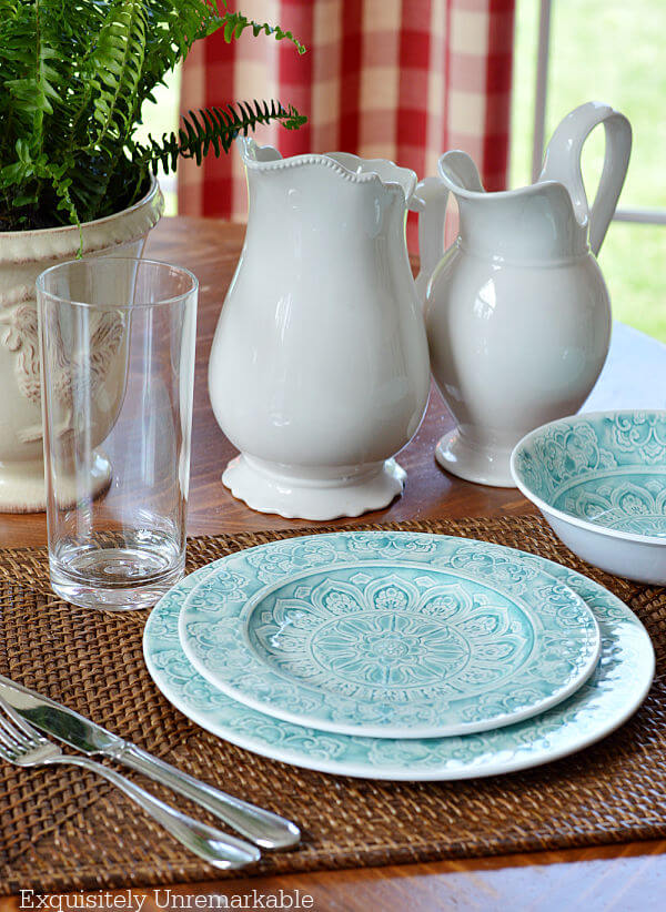 Melamine Plates set on a table with white pitchers and wicker placemats