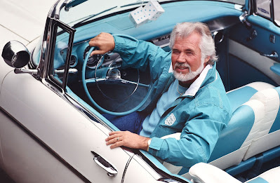 Christopher Cody Rogers' late father Kenny posing for picture with a vintage car